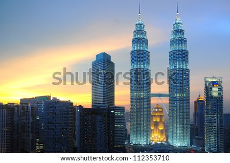 KUALA LUMPUR, MALAYSIA - MAY 19: Petronas Twin Towers at twilight on May 19, 2012 in Kuala Lumpur. Petronas Twin Towers are twin skyscrapers and were tallest buildings in the world from 1998 to 2004.