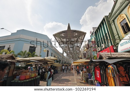 KUALA LUMPUR, MALAYSIA - MAY 9: Tourists in KL Central Market on May 9, 2012 in Kuala Lumpur, Malaysia. The market was constructed in 1888 as a wet market and refurbished into a cultural bazaar.