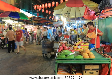 KUALA LUMPUR MALAYSIA - 24 MAY, 2014:Unidentified people shop at Chinatown. China town, also known as Petaling street is a popular tourist destination and has dozens of restaurants and food stalls.  #323794496