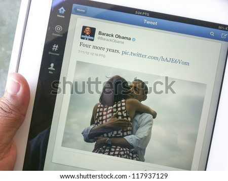 KUALA LUMPUR, MALAYSIA-NOV. 7:Screen capture of tweet 'Four more years' by Barack Obama on Nov. 7, 2012 in Kuala Lumpur. Barack Obama defeated Mitt Romney for the second term in office. - stock photo