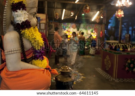 KUALA LUMPUR, MALAYSIA - NOVEMBER 5: Devotees pray to deity Hanuman on Diwali festival day on November 5, 2010 at the Hanuman Temple in Kuala Lumpur.  Diwali celebrates the triumph of good over evil.