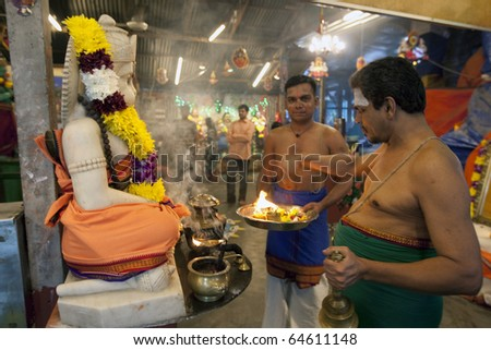 KUALA LUMPUR, MALAYSIA - NOVEMBER 5: Temple priests offer prayers on Diwali festival day on November 5, 2010 at the Hanuman Temple in Kuala Lumpur.  Diwali celebrates the triumph of good over evil.