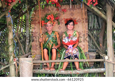 KUALA LUMPUR, MALAYSIA - NOVEMBER 28: The ethnic orang asli (aboriginal peoples) of Malay wearing traditional cloth at the Malaysia Wedding Exhibition on NOVEMBER 28, 2010 in KUALA LUMPUR, MALAYSIA - stock photo