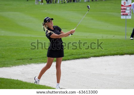 KUALA LUMPUR, MALAYSIA - OCTOBER 24: American Natalie Gulbis finishes her shot out of bunker on Day 3 of the Sime Darby LPGA Golf on October 24, 2010 in Kuala Lumpur, Malaysia