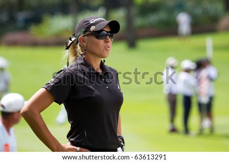 KUALA LUMPUR, MALAYSIA - OCTOBER 24: American Natalie Gulbis thinking of her next shot out of the bunker on Day 3 of the Sime Darby LPGA Golf on October 24, 2010 in Kuala Lumpur, Malaysia