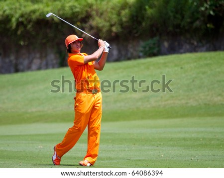 KUALA LUMPUR, MALAYSIA - OCTOBER 31:  American Rickie Fowler chips for Green on Day 4 of the CIMB Asia Pacific Golf Classic on October 31, 2010 in Kuala Lumpur, Malaysia. Fowler finished 5th - stock photo