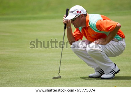 KUALA LUMPUR, MALAYSIA - OCTOBER 29: British Brian Davis looks for his putting line on Day 2 of the CIMB Asia Pacific Golf Classic on October 29, 2010 in Kuala Lumpur, Malaysia