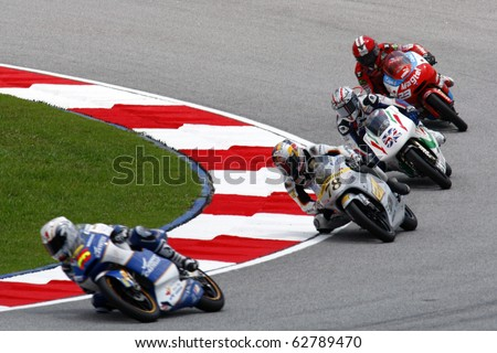 KUALA LUMPUR, MALAYSIA - OCTOBER 9: 125cc riders race at the qualifying session during the 2010 Malaysian Motorcycle Grand Prix on October 9, 2010 at the Sepang International Circuit, Malaysia.