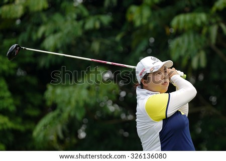 KUALA LUMPUR, MALAYSIA - OCTOBER 10, 2015: China\'s Shanshan Feng tees off at the sixth hole of the KL Golf & Country Club on Round 3 day at the 2015 Sime Darby LPGA Malaysia golf tournament.