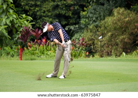 KUALA LUMPUR, MALAYSIA - OCTOBER 29: Korean Charlie Wi shoots for the Green on Day 2 of the CIMB Asia Pacific Golf Classic on October 29, 2010 in Kuala Lumpur, Malaysia