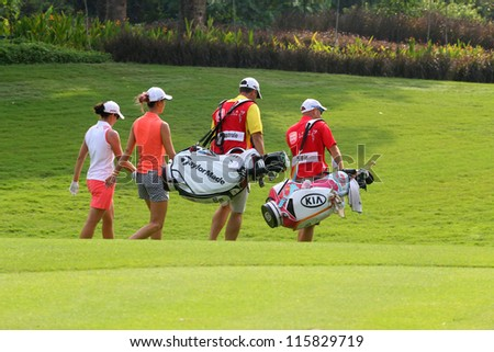 KUALA LUMPUR, MALAYSIA - OCTOBER 10: Michelle Wie of the USA and Nicole Castrale USA during the Sime Darby LPGA 2012 golf tournament on Oct 10, 2012 in Kuala Lumpur, Malaysia.