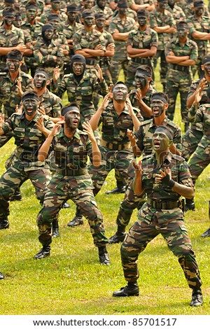 KUALA LUMPUR, MALAYSIA - SEPT. 30: Battalion Lekir group performs war dance at National Defense University Of Malaysia, Kuala Lumpur, Malaysia on Friday September 30, 2011. - stock photo