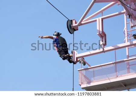 Kuala Lumpur, Malaysia – September 30, 2018: Base Jumpers jump from a 300m high deck during the Kuala Lumpur Tower International Jump. #1197803881
