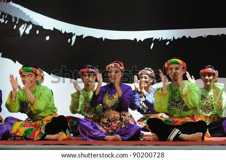 """KUALA LUMPUR, MALAYSIA - SEPTEMBER 16: PETRONAS Performing Arts Group performs """"dikir barat """" during MASIF Fashion Show  September 16, 2010 in Kuala Lumpur, Malaysia"""