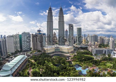 KUALA LUMPUR, MALAYSIA - SEPTEMBER 28: View of The Petronas Twin Towers on September 28, 2010 in Kuala Lumpur. The skyscraper (451.9m/88 floors) is the tallest twin buildings in the world