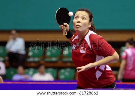 KUALA LUMPUR, MALAYSIA - SEPTEMBER 24: Wang Yuegu, Singapore (ITTF World Rank 21) tosses ball to serve at the Volkswagen 2010 Women\'s World Cup in table tennis on September 24, 2010 in Kuala Lumpur.