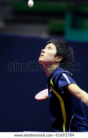 KUALA LUMPUR, MALAYSIA - SEPTEMBER 24: Yang Fen of Congo serves in her match at the Volkswagen 2010 Women's World Cup in table tennis on September 24, 2010 in Kuala Lumpur.
