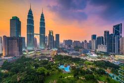 Kuala Lumpur, Malaysia skyline at dusk over the park.