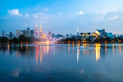 Kuala Lumpur, Malaysia. Sunrise City skyline with The Twin Towers from Titiwangsa lake.