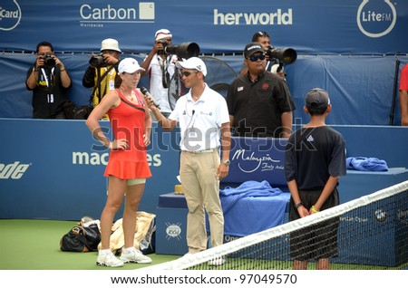 KUALA LUMPUR- MAR. 4:Jelena Jankovic comments during a semi-finals match against Petra Martic at the BMW Malaysian Open on March 4, 2012 in Kuala Lumpur. Petra Martic won [6-7(5-7),7-5,7-6 (7-5)]
