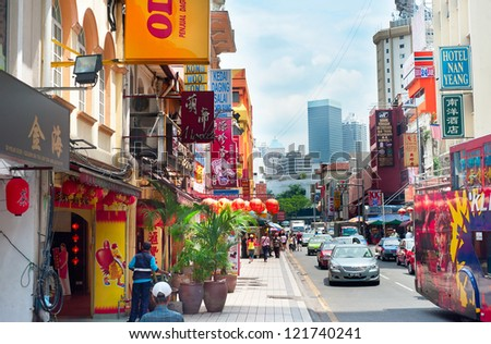 KUALA LUMPUR - MARCH 20: Chinatown street on March 20, 2012 in Kuala Lumpur. KL is the capital and most populous city in Malaysia. Covers an area of 243 km2 and has population of 1.6 million in 2012