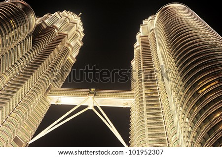 KUALA LUMPUR - MARCH 20: Petronas Twin Towers on March 20, 2012 in Kuala Lumpur. Petronas Twin Towers were the tallest buildings in the world from 1998 to 2004, but remain the tallest twin buildings