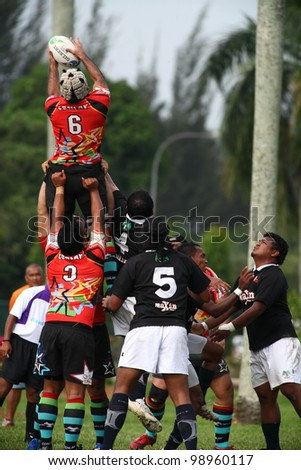 KUALA LUMPUR-MARCH 31: Players jostle for the ball from a line-out during a Malaysian Rugby Union(MRU) Super League match (Keris Conlay vs Bandaraya Dragons) on March 31,2012 in Kuala Lumpur,Malaysia
