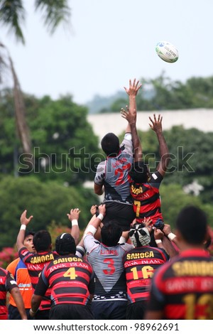 KUALA LUMPUR-MARCH 31: Players jostle for the ball from a line-out during a Malaysian Rugby Union(MRU) Super League 2012 match (UiTM Lions vs SAHOCA) on March 31,2012 in Kuala Lumpur,Malaysia
