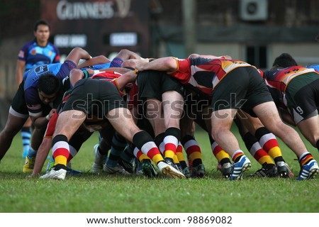 KUALA LUMPUR - MARCH 29: Rugby players scrum during the NICC final rugby match between SSTMI Bandar Penawar and RSC Dog on March 29,2012 in Kuala Lumpur, Malaysia. SSTMI won 24-15.