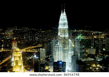 KUALA LUMPUR - MARCH 30: The Petronas Towers at night on March 30, 2011 in Kuala Lumpur, Malaysia. The Petronas Towers are the tallest twin buildings in the world - 1483 ft (452 meters).