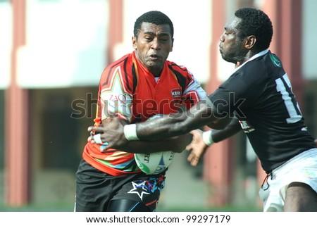 KUALA LUMPUR-MARCH 31:Unidentified Bandaraya Dragons player blocks a Keris Conlay player during a Malaysian Rugby Union(MRU) Super League match on March 31, 2012 in Kuala Lumpur, Malaysia. Conlay won 21-15