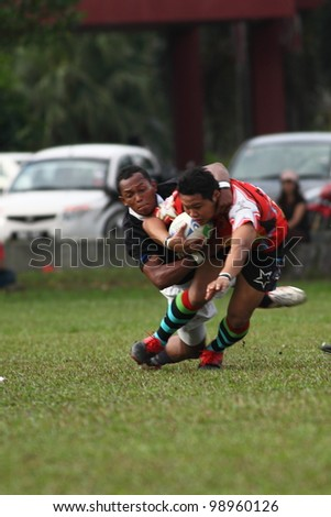 KUALA LUMPUR-MARCH 31:Unidentified Bandaraya Dragons player tackle Keris Conlay player during a Malaysian Rugby Union(MRU) Super League match on March 31,2012 in Kuala Lumpur,Malaysia.Conlay won 21-15