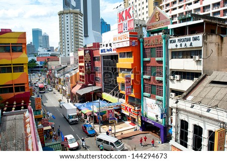 KUALA LUMPUR - MAY 11: Chinatown street on May 11, 2013 in Kuala Lumpur. KL is the capital and most populous city in Malaysia. Covers an area of 243 km2 and has population of 1.6 million in 2012