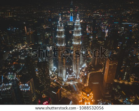 KUALA LUMPUR, MAY 2018 - Night aerial view of the Petronas Twin Towers, KLCC from a drone #1088532056