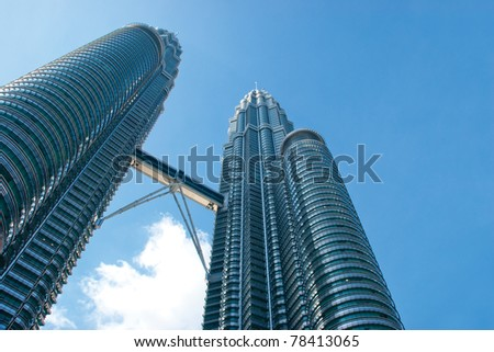 KUALA LUMPUR - MAY 28 : The Petronas Twin Towers (KLCC) with blue skies on May 28, 2011 in Kuala Lumpur, Malaysia. The skyscraper (451.9m/88 floors) remain the tallest twin buildings in the world.