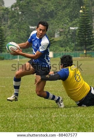 KUALA LUMPUR - OCT. 15: Unidentified players in action during Rugby 10s Tournament Vice-Chancellor Cup at National Defense University Of Malaysia on October 15, 2011 in Kuala Lumpur, Malaysia.