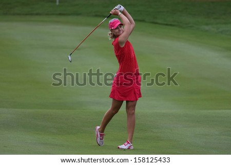 KUALA LUMPUR - OCTOBER 13: Anna Nordqvist of Sweden hits the ball to the 2nd hole green of the KLGCC course on the final day of the Sime Darby LPGA on October 13, 2013 in Kuala Lumpur, Malaysia.
