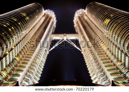 KUALA LUMPUR - OCTOBER 12: Beautiful night lighting of Petronas Twin Towers (PTT) October 12, 2006 in Kuala Lumpur. The skyscraper height is 451.9m - stock photo