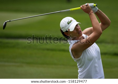KUALA LUMPUR - OCTOBER 13: Karine Icher of France reacts after her hit to the 9th hole of the KLGCC course on the final day of the Sime Darby LPGA on October 13, 2013 in Kuala Lumpur, Malaysia.