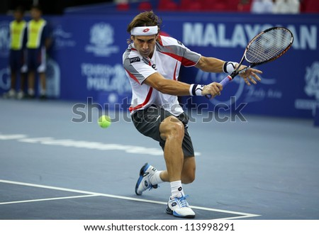 KUALA LUMPUR - SEP 27: David Ferrer of Spain plays his round 2 match at the ATP Tour Malaysian Open 2012 on September 27, 2012 at the Putra Stadium, Kuala Lumpur, Malaysia. He beat Alex Bogomolov Jr.