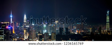 Kuala Lumpur, 10SEP2018 Malaysia:   Kuala Lumpur view, Malaysia. Night city lights  and panoramic view with Petronas Twin Towers, Menara KL Tower and  The Exchange 106 (center)