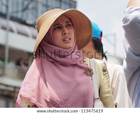 KUALA LUMPUR - SEPTEMBER 22 - Nurul Izzah Anwar, a member of parliment, at the protest against Innocence Muslim in front of the USA embassy on September 22, 2012. Kuala Lumpur