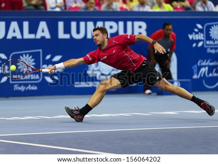 KUALA LUMPUR - SEPTEMBER 28: Stan Wawrinka plays a return to Julien Benneteau in a semi-final match of the Malaysia Open 2013 tennis played at the Putra Stadium, Malaysia on September 28, 2013.