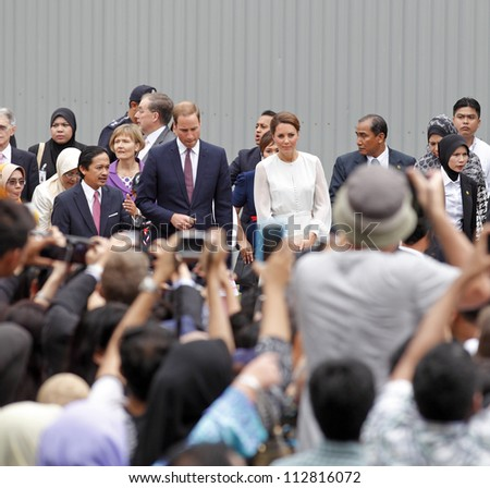 KUALA LUMPUR - SEPTEMBER 14: The Duke and Duchess of Cambridge attend a cultural event in KLCC Park on September 14, 2012 in Kuala Lumpur, Malaysia. The Royal couple is on the Diamond Jubilee tour. - stock photo
