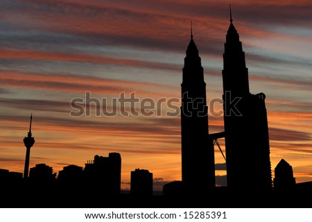 Kuala Lumpur skyline with Petronas Towers at sunset illustration