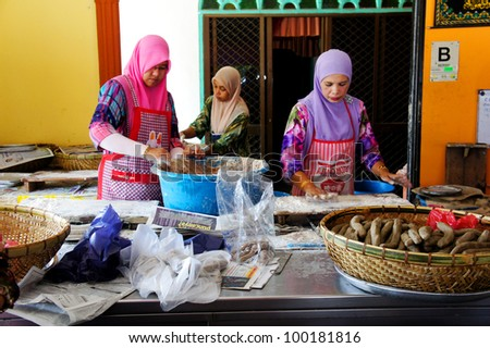 KUALA TERENGGANU, MALAYSIA-APR 16:Unidentified workers prepare 'keropok lekor' at Kampung Losong in K. Terengganu on April 16 2012. â??Keropok lekorâ?? or fish sausage is a popular food here made of fish
