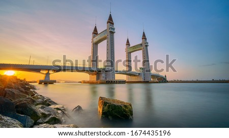 Kuala Terengganu, Malaysia - February 29, 2020 : Silky sea during sunrise over the Drawbridge which completed in 2019. Image will contains noise when zoom in actual size.