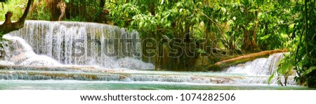 Kuang Si Falls in Laos, around 30 km from Luang Prabang. A Cascading rain forest stream within a jungle landscape.  #1074282506