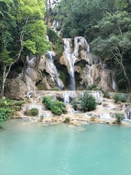 Kuang Si is a giant waterfall that flows through the limestone-rich jungle and empties out into a series of three gently cascading pools.