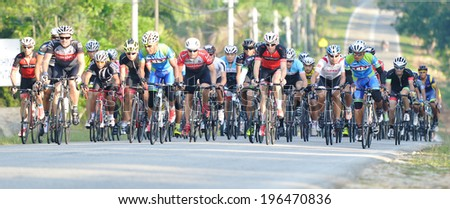 KUANTAN - JUNE 1: unidentified cyclists in action during Kuantan160 on June 1, 2014 in Kuantan, Pahang, Malaysia. KUANTAN160 is a non-profit, non-race 160KM bicycle ride around Kuantan City. #196470836